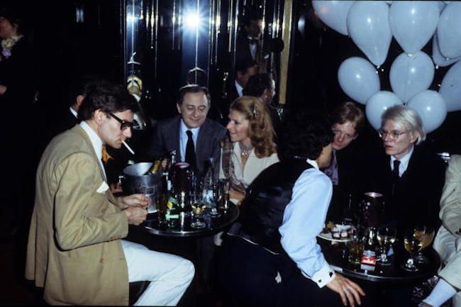 Yves Saint Laurent, Pierre Berger, and Andy Warhol at a party in le Palace in 1977 in Paris France